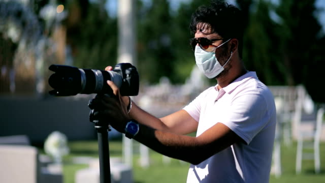 Cameraman wearing protective face mask during covid19