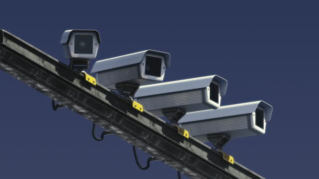 cctv cameras spying on someone. person's being watched. mass control, security - conspiracy стоковые видео и кадры b-roll