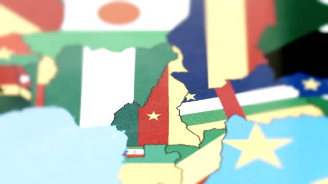 cameroon borders with national flag on world map - линия экватора стоковые видео и кадры b-roll