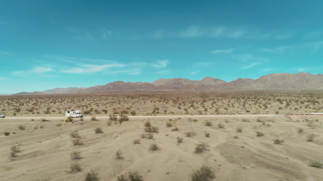 A camper passing through the image in the mojave desert