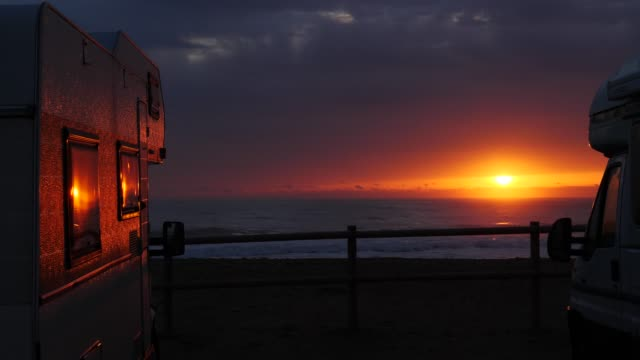 Camper rv on beach at sunrise, Spain video