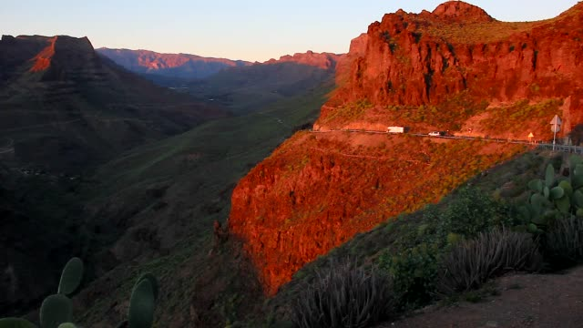 Camper van heading into canyon valley at sunset in Gran Canaria, Spain