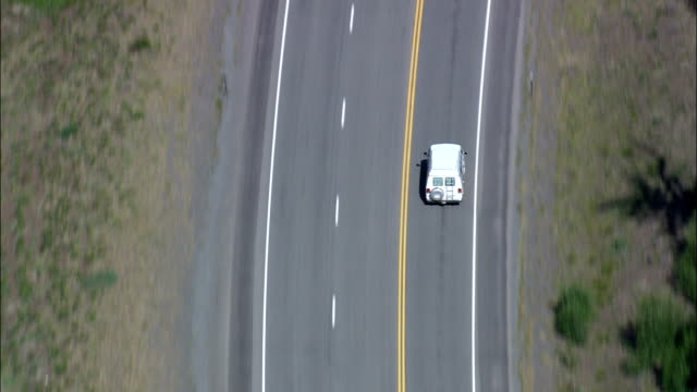 Camper Van On Route 20 By Shoshone River  - Aerial View - Wyoming,  Park County,  helicopter filming,  aerial video,  cineflex,  establishing shot,  United States video