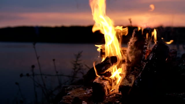 Campfire Burns Brightly At Sunset - video