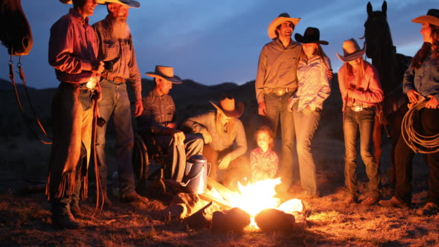 Campfire With Cowboys and Cowgirls at Night Cowboys and cowgirls gathering around the campfire wild west stock videos & royalty-free footage