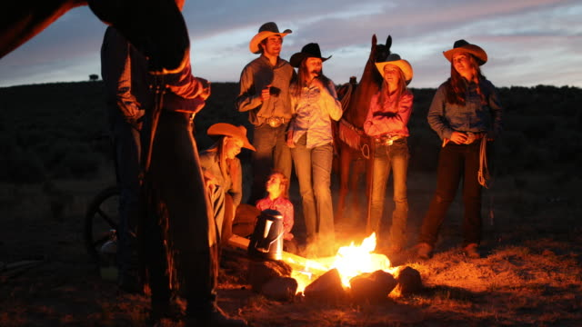 Campfire With Cowboys and Cowgirls at Night Cowboys and cowgirls gathering around the campfire cowgirl stock videos & royalty-free footage