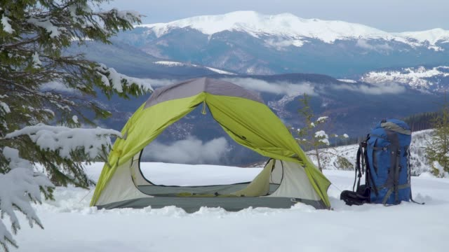 Camping in the winter mountains