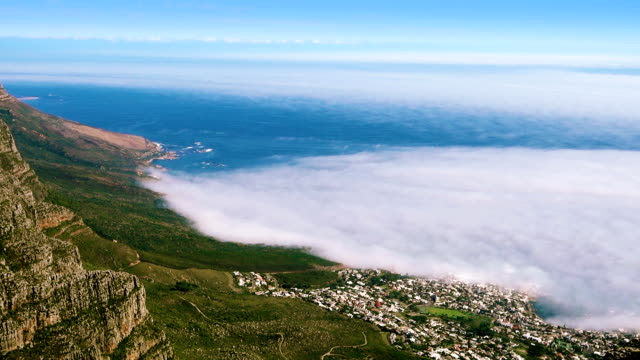 Camps Bay Aerial view of Camps Bay in Cape Town, South Africa from Table Mountain cape peninsula stock videos & royalty-free footage