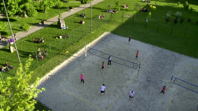 AERIAL Campus Sports Field HD1080p: AERIAL shot of people playing outdoor volleyball on the campus sports field. volleyball sport stock videos & royalty-free footage
