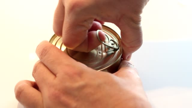 Can of tuna Man opening a can of tuna in olive oil tuna seafood stock videos & royalty-free footage