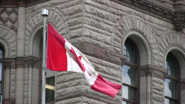 (hd1080i) canada: flag outside old city hall - toronto, ontario - canada flag stock videos & royalty-free footage