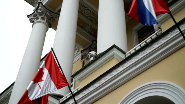 Canadian and russian flags video