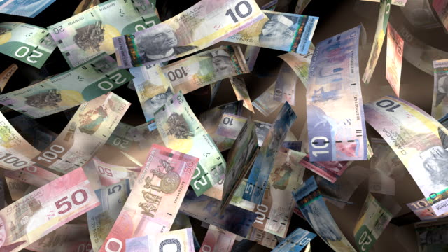 Canadian Currency Flying Through a Warm Light (Loop) video