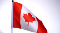 istock Canadian flag on flagpole flying and waving in the wind. 1203737668