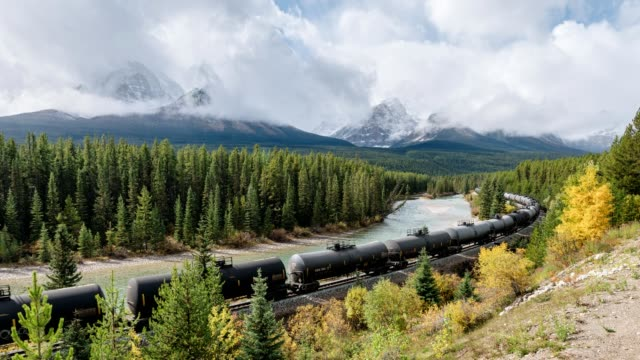 Canadian freight train passing through on Morant's curve in Banff national park