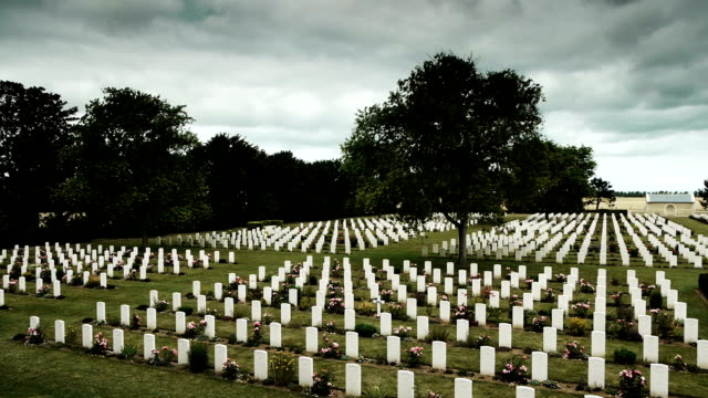 Canadian memorial crosses at a soldier cemetery in France A memorial cemetery of canadian soldiers of world war II. The graveyard is located in Normandy, france where many military died at the battle of Normandy at the coastlines. A shot of an overview of rows of white crosses. normandy stock videos & royalty-free footage