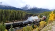istock Canadian Pacific Railway long freight passing in autumn valley on Bow river at Morant's Curve 1199734223