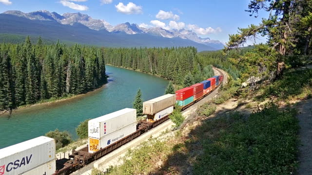 Canadian Railway Canadian Pacific Railway freight train near Bow River at Morants Curveat in Banff National Park, Canada oldest national park and part of a UNESCO World Heritage Site. tramway videos stock videos & royalty-free footage