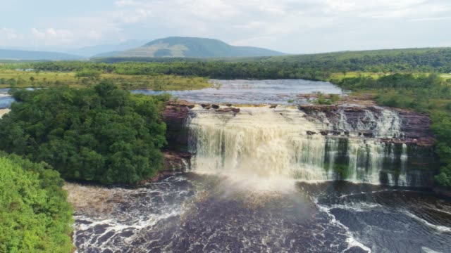 Canaima National Park Waterfalls aerial view and Carrao river. Canaima National Park, Venezuela El Sapo waterfall aerial view. Canaima National Park, Venezuela. La Gran Sabana, Bolivar State, Venezuela. Canaima is a world known place for the beauty of nature and countless waterfalls. Canaima is visited for tourist all around the world looking for adventure and nature encounters. back to back stock videos & royalty-free footage