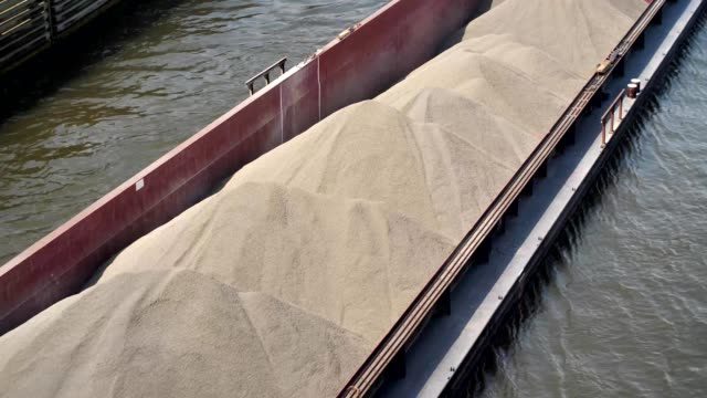 canal boat transporting sand - chiatta video stock e b–roll