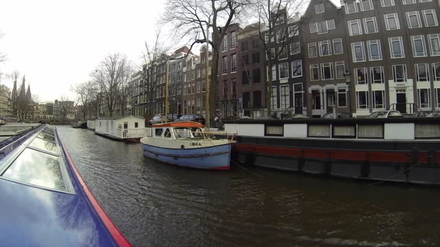 Canal in Amsterdam with Tourboat - 60fps