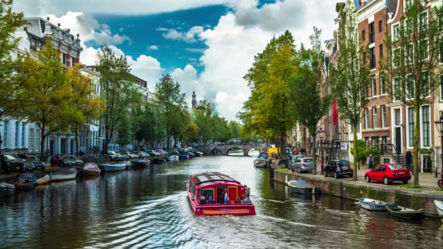 canals of amsterdam in the netherlands - canale video stock e b–roll