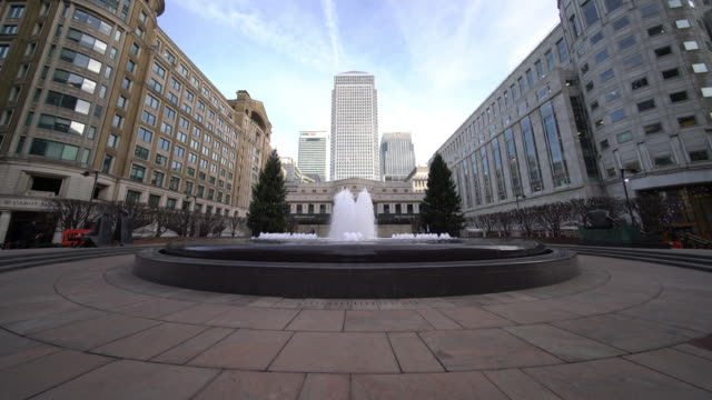 Canary wharf and Cabot place in London - 4k video Skyscrapers in Canary wharf with the fountain at Cabot place - London london architecture stock videos & royalty-free footage