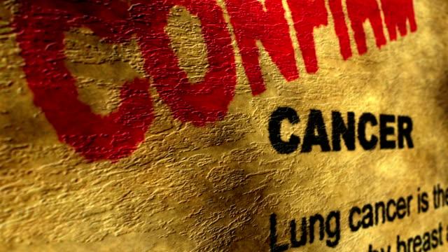 vídeos de stock, filmes e b-roll de câncer confirmar o conceito de grunge - validação