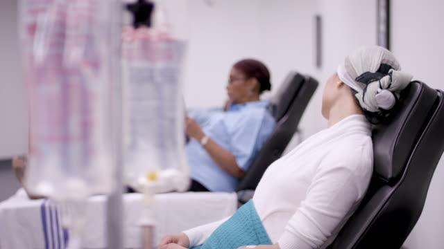 Cancer patient in oncology unit Asian woman with cancer in the oncology unit receiving chemotherapy treatment. oncology stock videos & royalty-free footage
