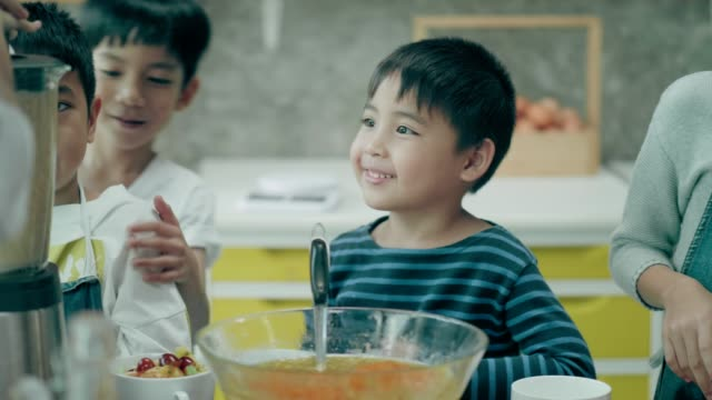 Candid of Thai cute school children queue to giving juice at school cooking class video