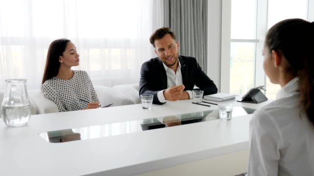 candidate and interviewers in white and spacious office, meeting with secretary and boss in boardroom, woman in modern office video