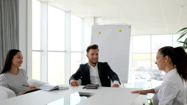 candidate during job interview into large company in white and spacious office, dialog on job with secretary and boss video