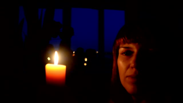 Candle A Girl Lights A Candle In A Dark Room Stock Video More