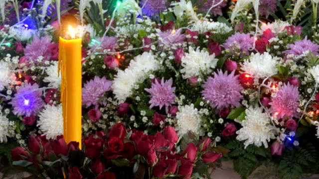 Candle and bunch of flowers