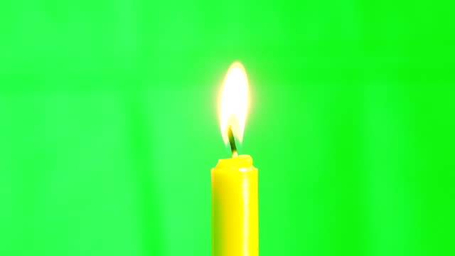 candle burning concept, slow motion fire flame burning candle on green screen - fiamma video stock e b–roll