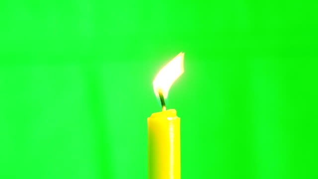 Candle burning concept, Slow motion fire flame burning candle on green screen