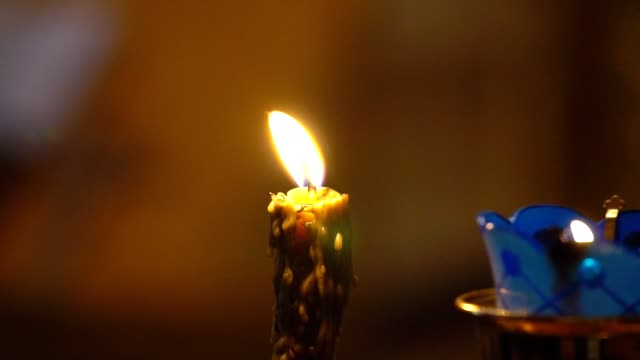 Candle Burns in The Church. Slow motion video