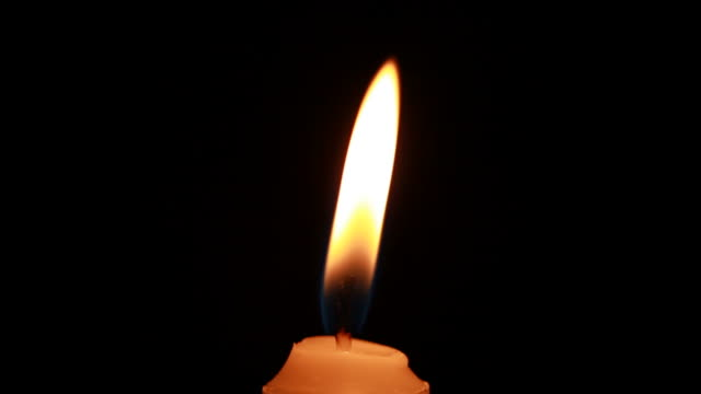 Candle flame Close-up of a candle flame candle stock videos & royalty-free footage
