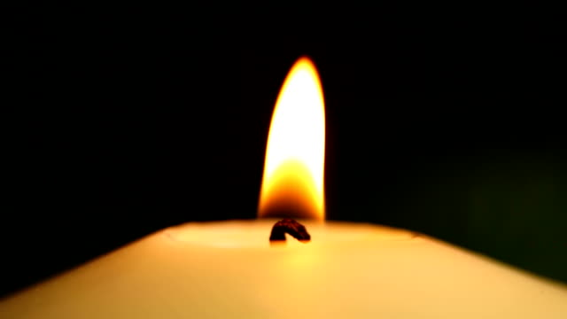 candle in the dark - close up video
