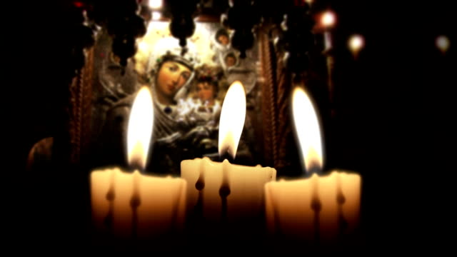 Candle in the night, close up, inside church, loop video