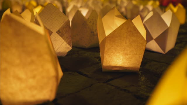 Candle lanterns on the ground. video