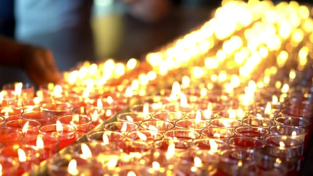 Candle Lighting, prayer candle in church.