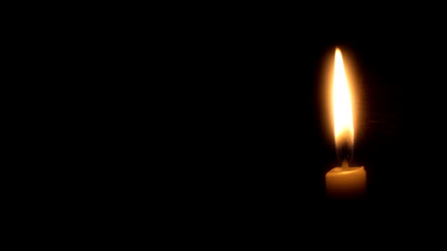 Candle Loop Loop-able clip of a single candle on black. candle stock videos & royalty-free footage