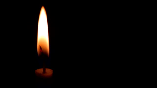 Candle on a black background video