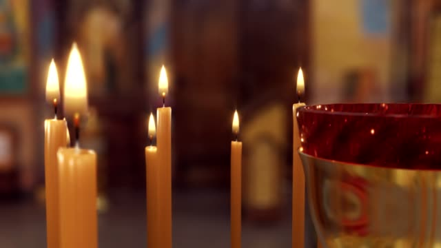 Candle on Candlestick Holder in Church