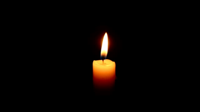 Candle A single candle burning on dark candle stock videos & royalty-free footage