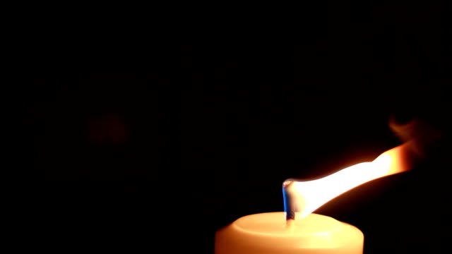 Candle with fire Candles with lights, close up shots, black background. low lighting stock videos & royalty-free footage