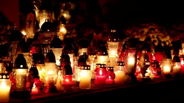 Candlelights burning at a cemetery