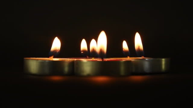 Candlelights in black background video
