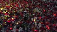 istock Candles Burning for Victims of Political Oppression 1190148754